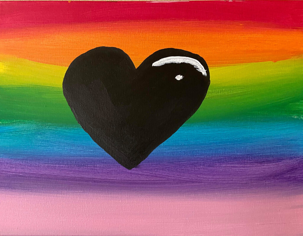 A rainbow painted on canvas with a black heart in the middle
